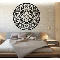 Abgerundet wird das Mandala des Lebens durch ein Holzbild an einer Wand aus SUSEN-Sperrholz